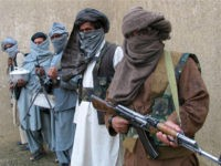 Taliban guerrilla fighters hold their weapons at a secret base in eastern Afghanistan in this February 3, 2007 file photo. Taliban militants killed 15 Afghan guards working for a private U.S. security firm in an ambush in the west of the country on Tuesday, the provincial... REUTERS/SAEED ALI ACHAKZAI/FILES