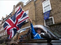 EU referendum. A London taxi driver waves a Union Jack flag in Westminster, London after Britain voted to leave the European Union in an historic referendum which has thrown Westminster politics into disarray and sent the pound tumbling on the world markets. Picture date: Friday June 24, 2016. See PA story POLITICS EU. Photo credit should read: Stefan Rousseau/PA Wire URN:26700726 (Press Association via AP Images)