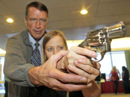teacher-guns. Rick Bowmer AP
