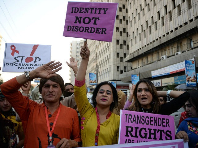 Pakistani transgenders carry placards as they rally to mark World Aids Day in Karachi on November 30, 2013. World AIDS Day is celebrated on December 1 every year to raise awareness about HIV/AIDS and to demonstrate international solidarity in the face of the pandemic. AFP PHOTO/Asif HASSAN (Photo credit should read ASIF HASSAN/AFP/Getty Images)