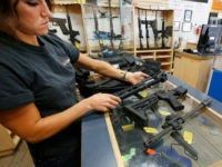 SPRINGVILLE, UT - JUNE 17: Courtney Manwaring unpacks an AR-15 semi-automatic gun kit at Action Target on June 17, 2016 in Springville, Utah. Semi-automatics are in the news again after the nightclub shooting in Orlando F;lord last week. (Photo by George Frey/Getty Images)