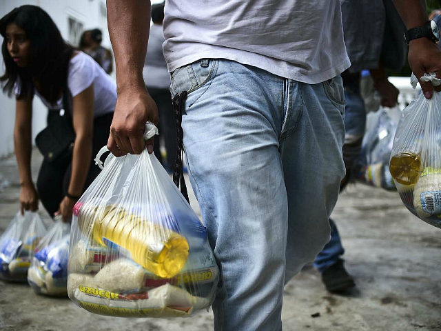 Bags of basic foodstuffs are pictured in one of the food distribution centers called CLAP (Local Committees for Supply and Production), which are headed by community leaders, in the poor neighbourhood of 23 de Enero, in Caracas, on June 4, 2016. Shortages of basic goods have fueled looting, violent crime …