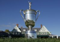 The US Open Championship Trophy is displayed in front of the clubhouse at Oakmont Country Club in Pennsylvania