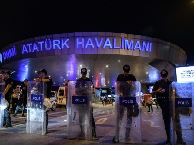 Turkish police officers block the main entrance of the Ataturk airport in Istanbul on June 28, 2016