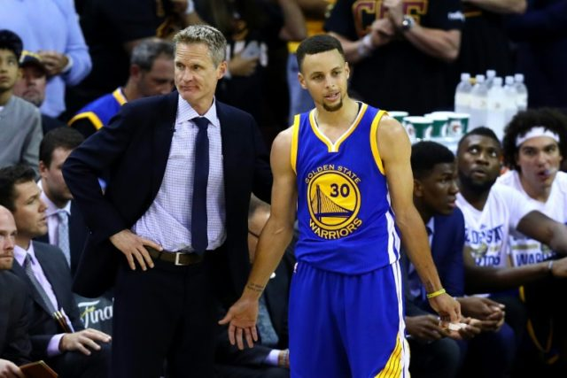 Steve Kerr of the Golden State Warriors (L) and Stephen Curry react in the second half against the Cleveland Cavaliers in Game 6 of the NBA Finals on June 16, 2016