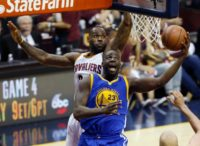 Golden State Warriors forward Draymond Green (R) shoots the ball in front of Cleveland Cavaliers forward LeBron James (L) during Game 3 of the NBA Finals in Cleveland, Ohio on June 8, 2016