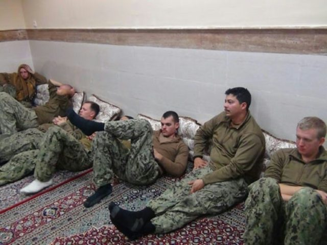 US sailors are held under detention by Iran's Revolutionary Guards in the Farsi Island after their patrol boats appeared to stray into Iranian waters in January 2016
