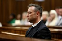 South African paralympian Oscar Pistorius looks on during the third day of his hearing at the Pretoria High Court on June 15, 2016