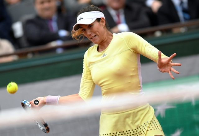 Spain's Garbine Muguruza returns the ball to Serena Williams of the US during the French Open women's final at Roland Garros in Paris on June 4, 2016