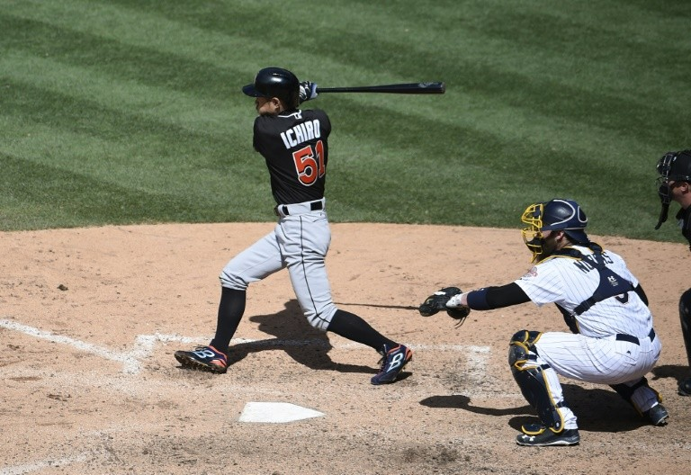 Ichiro Suzuki of the Miami Marlins hits a double during the ninth inning against the San Diego Padres at PETCO Park