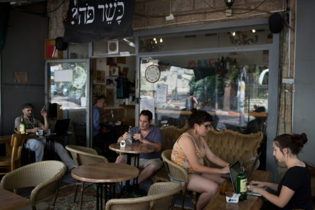 Customers sit at the Carousela restaurant, which was supervised by Hashgaha Pratit - Hebrew for private supervision - to check it abides by kosher practices in Jerusalem's Rehavia neighbourhood