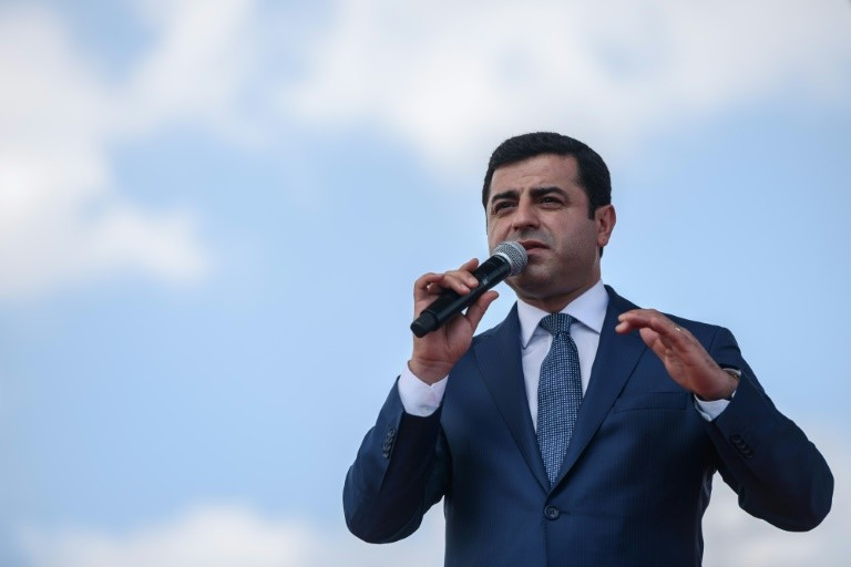 Co-leader of pro-Kurdish Peoples' Democratic Party Selahattin Demirtas delivers a speech on June 5, 2016 in Istanbul during a rally on lawmakers' immunity
