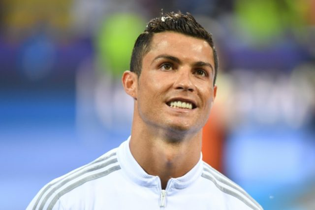 Cristiano Ronaldo, pictured before kick-off in the Champions League final in May, which his club Real Madrid won after the Portugeuse striker converted the winning penalty in a shoot out against Atletico Madrid