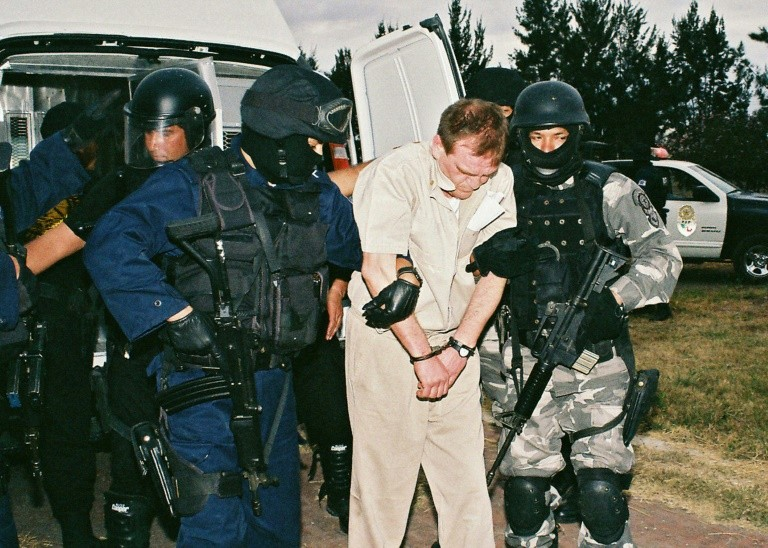 "Hector Luis ""El Guero"" Palma Salazar (C), was arrested by Mexican authorities in 1995 and extradited to the United States in 2007"