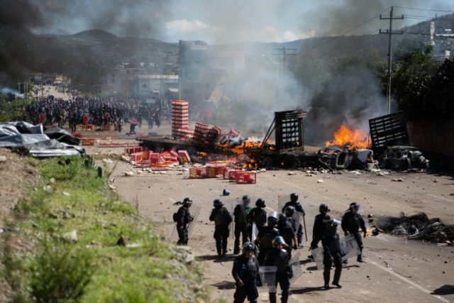 Members of the Mexican Federal Police clash with teachers holding a protest against  education reform in Oaxaca State on June 19, 2016