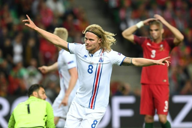 Iceland's midfielder Birkir Bjarnason celebrates the team's first goal during the Euro 2016 match against Portugal in Saint-Etienne on June 14, 2016
