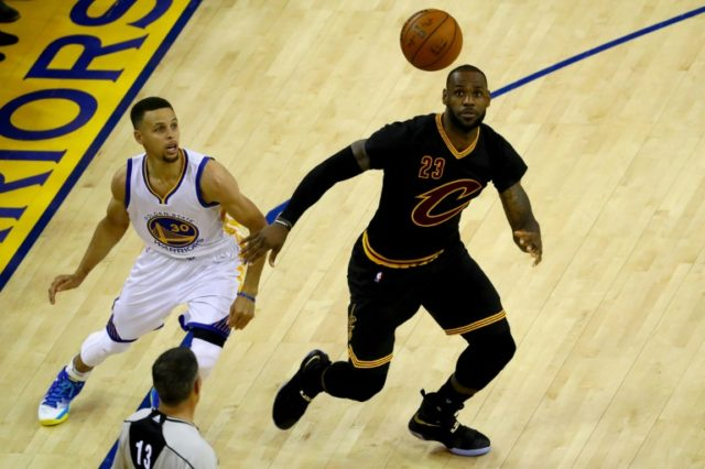 Stephen Curry (L) of the Golden State Warriors looks for the rebound against LeBron James of the Cleveland Cavaliers in Game 5 of the 2016 NBA Finals, at ORACLE Arena in Oakland, California, on June 13