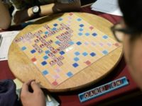 Participants play Scrabble during the King's Cup tournament in Bangkok
