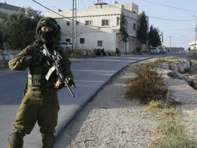 Israel locked down the West Bank town of Yatta on June 9, as they searched for clues after two Palestinian gunmen shot dead four people at a popular Tel Aviv nightspot
