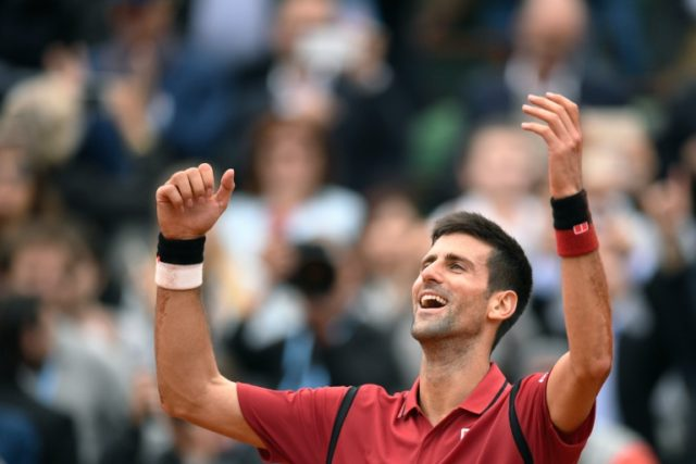 Serbia's Novak Djokovic reacts after winning the French Open on June 5, 2016