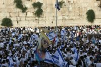 Israelis gather at the Western Wall in Jerusalem's old city on June 5, 2016 with their national flags as they celebrate the Jerusalem day which marks Israel's 1967 seizure of the Palestinian-dominated eastern half of Jerusalem