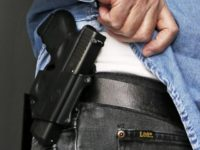 FILE - In this Feb. 27, 2013 file photo Hank Johnson displays his handgun, in Springboro, Ohio. Dealing a blow to gun supporters, a federal appeals court ruled Thursday, June 9, 2016, that Americans do not have a constitutional right to carry concealed weapons in public. (AP Photo/Al Behrman, File)