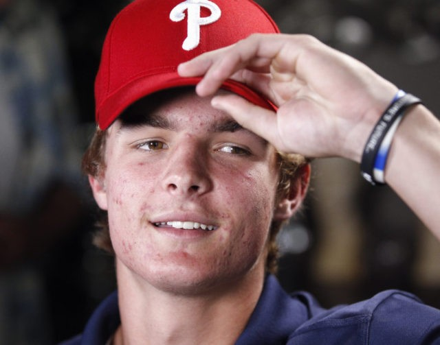 La Costa Canyon baseball player Mickey Moniak puts on a Phillies cap just after it was announced that the Philadelphia Phillies picked him as the number one MLB draft pick.