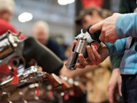 An attendee handles a revolver in the Sturm, Ruger & Co., Inc. booth on the exhibition floor of the 144th National Rifle Association (NRA) Annual Meetings and Exhibits at the Music City Center in Nashville, Tennessee, U.S., on Saturday, April 11, 2015. Top Republican contenders for their party's 2016 presidential nomination are lining up to speak at the annual NRA event, except New Jersey Governor Chris Christie and Kentucky Senator Rand Paul, who were snubbed by the country's largest and most powerful gun lobby. Photographer: Daniel Acker/Bloomberg via Getty Images