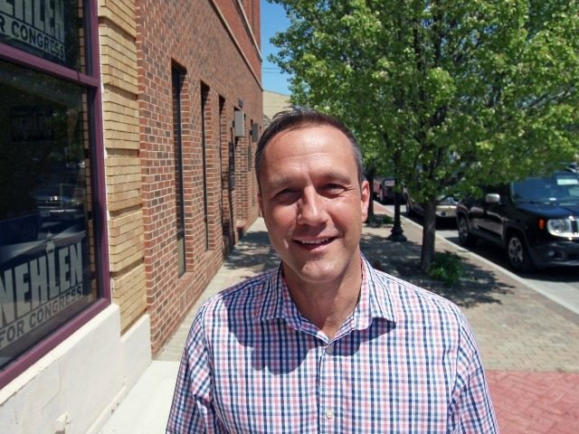 In this photo taken Thursday, May 19, 2016, in Kenosha, Wis. Paul Nehlen, a Republican, stands outside his campaign office. He plans to take on U.S. Rep. Paul Ryan, also a Republican, in the Aug. 9 primary. (