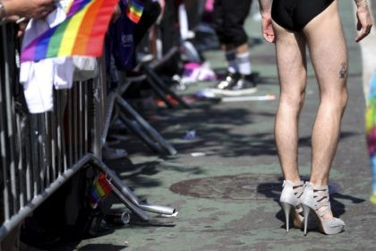 A man wears very tall and sparkling high heel shoes while participating in the NYC Pride Parade in New York, Sunday, June 26, 2016. With a moment of silence followed by the roar of motorcycles, New York City's gay pride parade kicked off Sunday, a celebration of barriers breached and …