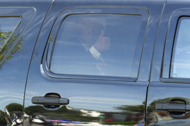 Republican presidential candidate Donald Trump gives a thumbs-up as he departs a meeting with Republican House members at the Capitol Hill Club in Washington, Thursday, July 7, 2016.