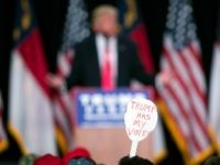 A supporter of Republican presidential candidate Donald Trump holds a sign during a campaign rally, Monday, July 25, 2016, in Winston-Salem, N.C. (