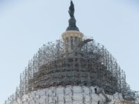 Scaffolding still wraps around the Senate and the Capitol Dome as part of a long-term repair project, but some of it has been removed from the very top of the structure around the Statue of Freedom, in Washington, Wednesday, March 9, 2016. The rest of the work, including restoration to the interior of the rotunda, will be completed before the 2017 presidential inauguration. (