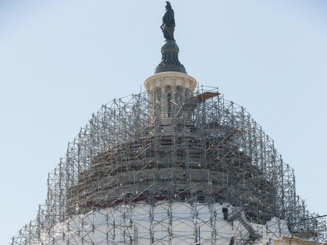 Scaffolding still wraps around the Senate and the Capitol Dome as part of a long-term repair project, but some of it has been removed from the very top of the structure around the Statue of Freedom, in Washington, Wednesday, March 9, 2016. The rest of the work, including restoration to …