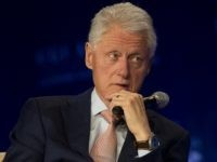 Former President Bill Clinton listens as former President Jimmy Carter speaks at Clinton Global Initiative meeting Tuesday, June 14, 2016, in Atlanta. (AP Photo/John Bazemore)