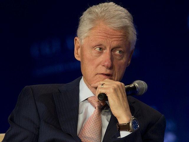Former President Bill Clinton listens as former President Jimmy Carter speaks at Clinton Global Initiative meeting Tuesday, June 14, 2016, in Atlanta. (AP Photo/John Bazemore)