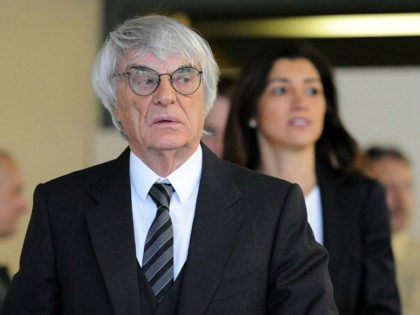 Formula One boss Bernie Ecclestone and his wife Fabiana Flosi leaves the court room of the district court in Munich, Germany, 13 May 2014. Ecclestone stands accused of paying former member of the board of BayernLB 44 million euros in bribes and taking a huge part of that sum back …