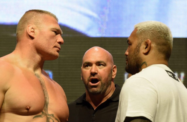 LAS VEGAS, NV - JULY 08: UFC President Dana White (C) looks on as mixed martial artists Brock Lesnar (L) and Mark Hunt (R) face off during their weigh-in for UFC 200 at T-Mobile Arena on July 8, 2016 in Las Vegas, Nevada. The fighters will meet in a heavyweight …