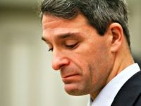 Virginia Attorney General Ken Cuccinelli gets choked up as he announces the exoneration of Thomas Hanesworth during a press conference in Richmond, Va., Tuesday, Dec. 6, 2011.  Haynesworth spent 27 years in prison for two 1984 sexual assault convictions.  (AP Photo/Steve Helber)