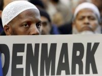 "New York, UNITED STATES:  Several hundred Muslims from the New York City area hold a protest in front on the Danish Consulate 17 February 2006 against the publication of cartoons depicting Islamic Prophet Muhammad that appeared in newspapers in Denmark. US Secretary of State Condoleezza Rice expressed concern earlier this week that Muslim outrage over the cartooons could ""spin out of control,"" particularly if fueled by countries like Iran and Syria.  AFP PHOTO/Timothy A. CLARY  (Photo credit should read TIMOTHY A. CLARY/AFP/Getty Images)"