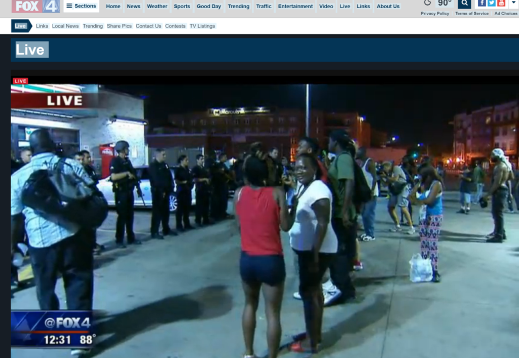 FOX 4 LIVE 1237 PPL GATHERED IN FRONT OF STORE