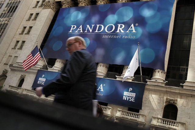 NEW YORK, NY - JUNE 15: A banner for Pandora Media Inc., the online-radio company, hangs in front of the New York Stock Exchange walk on its first day of trading as a public company on June 15, 2011 in New York City. Pandora stock rose as much as 63 …