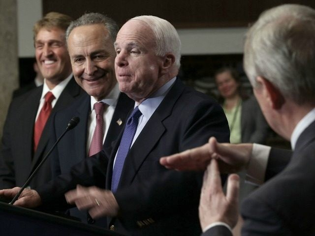 WASHINGTON, DC - APRIL 18: U.S. Sen. John McCain (R-AZ) (3rd L) speaks as Sen. Richard Durbin (D-IL) (R) gestures as Sen. Jeff Flake (R-AZ) (L), and Sen. Chuck Schumer (D-NY) (2nd L) look on during a news conference on immigration reform April 18, 2013 on Capitol Hill in Washington, …