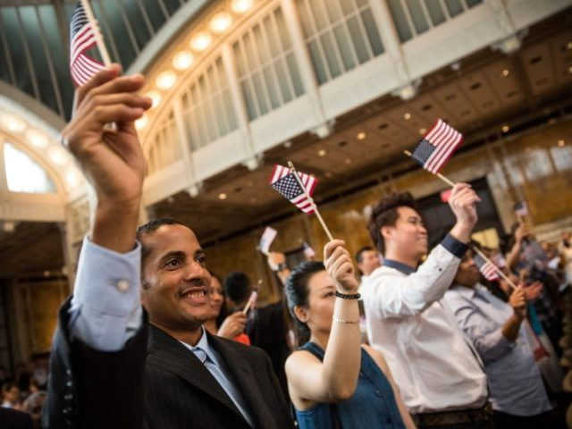 NEW YORK, NY - JULY 02:  A man who chose not to give him name takes part in an United States naturalization ceremony ahead of Indepedence Day, at the New York Public Library, in a wing of the library where a copy of the Declaration of Independence, written by Thomas Jefferson is currently being displayed, on July 2, 2014 in New York City. 150 new U.S. citizens participated in the ceremony, representing 47 countries.  (Photo by Andrew Burton/Getty Images)