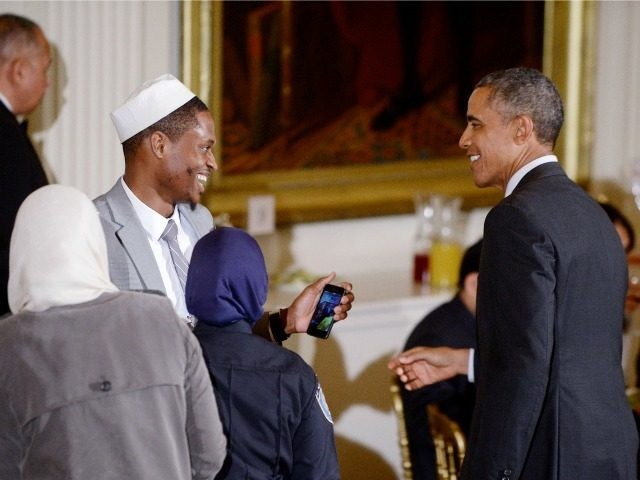 US President Barack Obama greets guests during an Iftar dinner celebrating Ramadan in the East Room of the White House in Washington, DC, July 22, 2015.Photo by