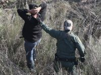 LA GRULLA, TX - DECEMBER 09: A U.S. Customs and Border Protection agent detains undocumented immigrants near the U.S.-Mexico border on December 10, 2015 at La Grulla, Texas. Border security remains a key issue in the U.S. Presidential campaign. (Photo by John Moore/Getty Images)