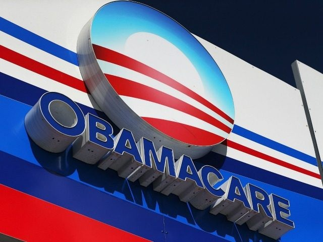 Obamacare sign is seen on the UniVista Insurance company office on December 15, 2015 in Miami, Florida.