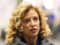 U.S. Representative Debbie Wasserman Schultz (D-FL 23rd District) and chair of the Democratic National Committee (DNC) speaks to a reporter before the democratic debate on December 19, 2015 in Manchester, New Hampshire. The DNC has been criticized for the timing of democratic debates during the 2016 presidential race. (Photo by Andrew Burton/Getty Images)