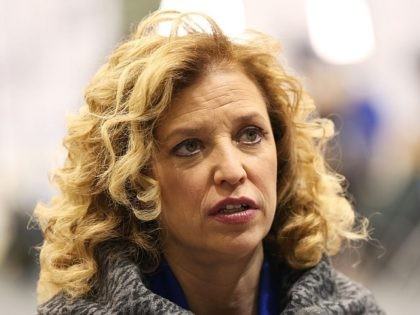 U.S. Representative Debbie Wasserman Schultz (D-FL 23rd District) and chair of the Democratic National Committee (DNC) speaks to a reporter before the democratic debate on December 19, 2015 in Manchester, New Hampshire. The DNC has been criticized for the timing of democratic debates during the 2016 presidential race. (Photo by …