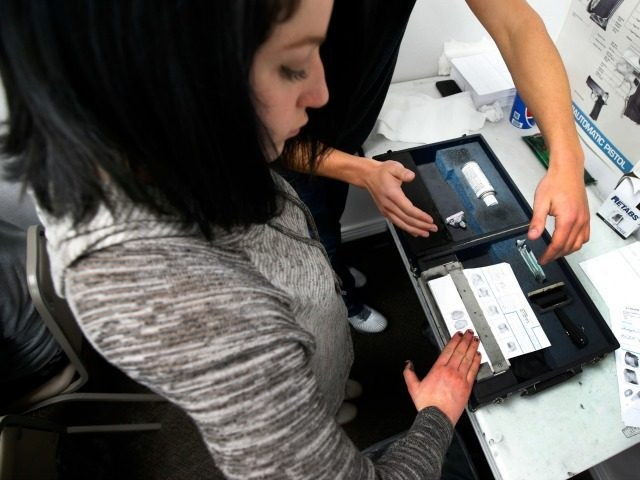 An unidentified person has her fingerprints taken as part of a Utah concealed gun carry permit class, at Range Master of Utah, on January 9, 2016 in Springville, Utah.